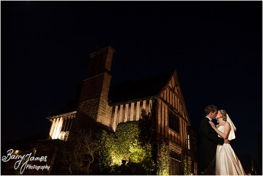 Creative night time portraits outside by the lake at The Moat House in Acton Trussell by Contemporary and Reportage Wedding Photographer Barry James