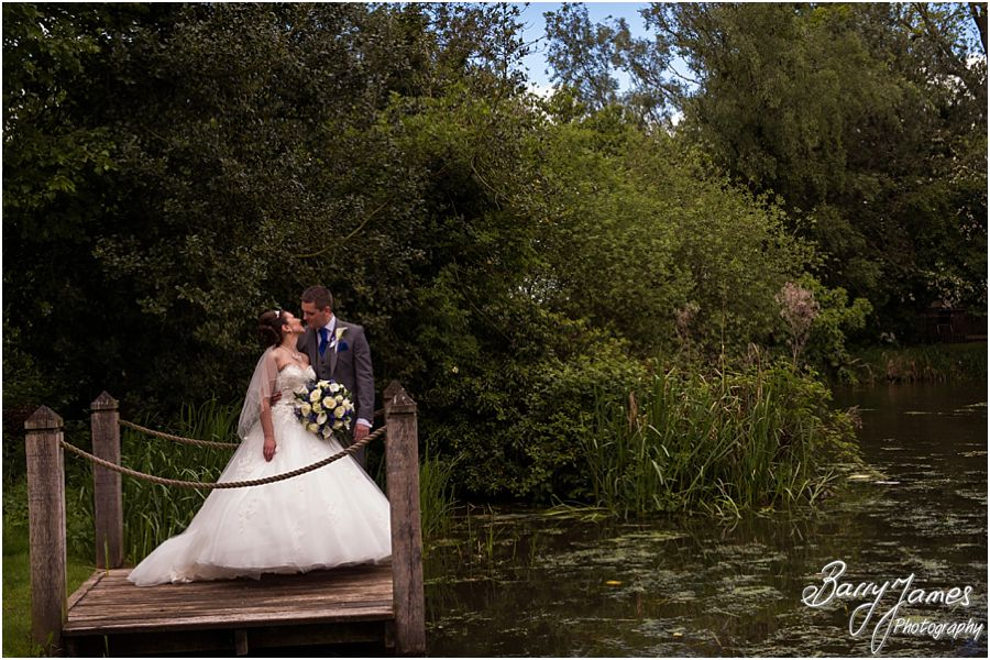 Contemporary and creative portraits of the bride and groom around the grounds of The Moat House in Acton Trussell by Contemporary Wedding Photographer Barry James