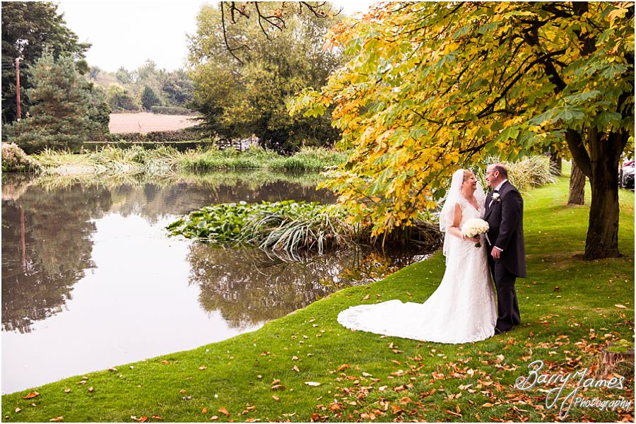 Classic and relaxed couple portraits around the autumnal grounds of The Moat House in Acton Trussell by Stafford Wedding Photographer Barry James