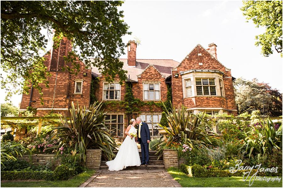 Creative portraits utilising the beautiful featured in the gardens at Moxhull Hall in Sutton Coldfield by Sutton Coldfield Wedding Photographer Barry James