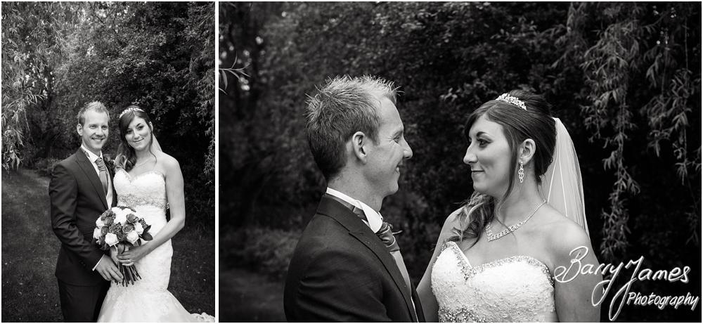 Creative contemporary photographs of the bride and groom around the beautiful gardens at Calderfields in Walsall by Walsall Wedding Photographers Barry James