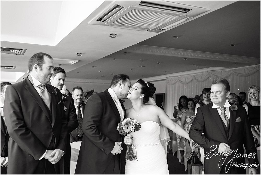 Storytelling photographs of the entrance of the bride to the ceremony at The Moat House in Staffordshire by Stafford Wedding Photographer Barry James