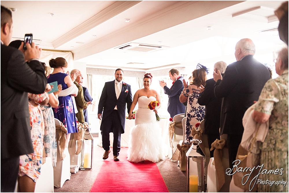 Photographs of the fabulous recessional of the Bride and Groom at The Moat House in Staffordshire by Stafford Wedding Photographer Barry James