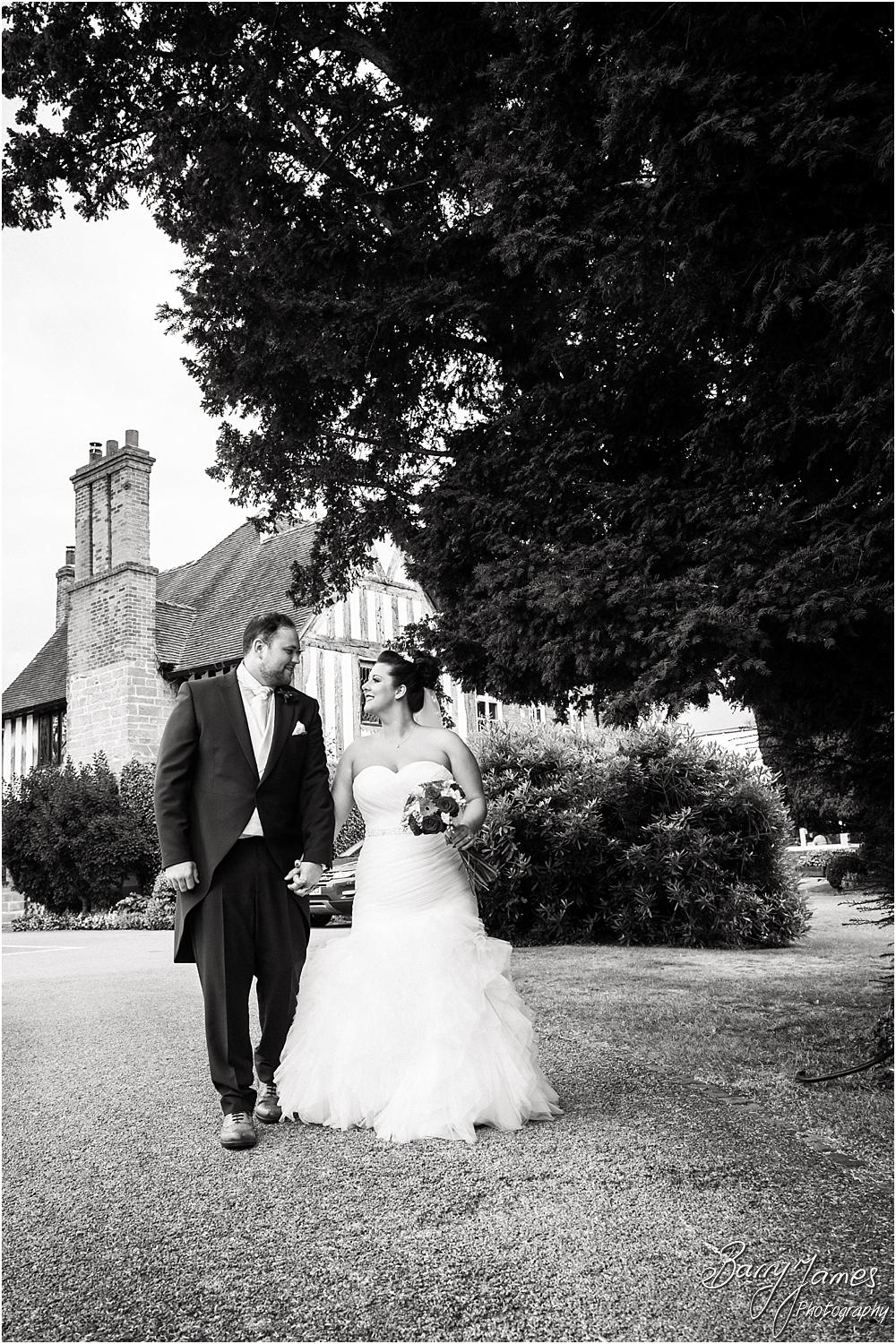 Elegant portraits on the lake at The Moat House in Staffordshire by Stafford Wedding Photographer Barry James