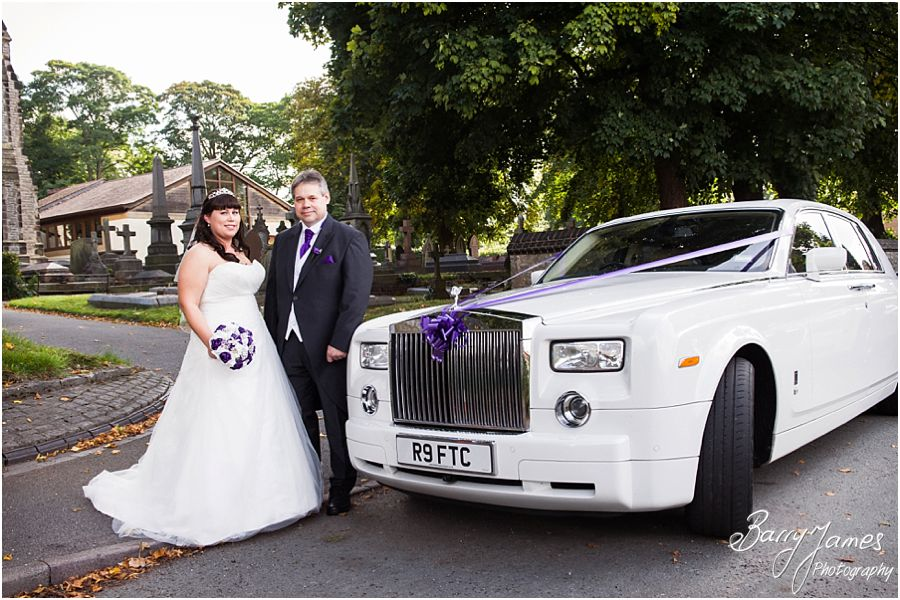 Bride and father arrival in Rolls Royce Limousine at Rushall Parish Church in Walsall by Walsall Wedding Photographer Barry James