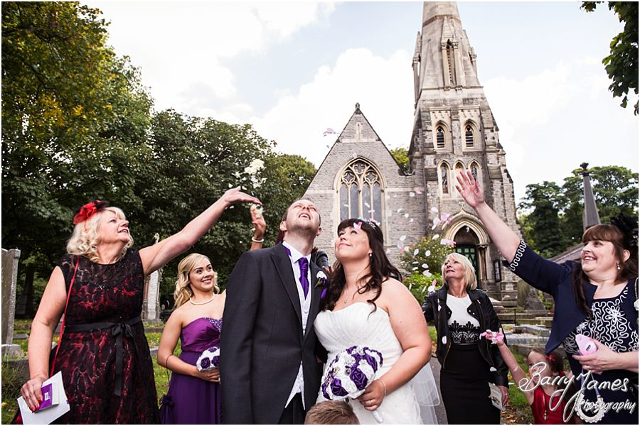 Confetti fun at Rushall Parish Church in Walsall by Walsall Wedding Photographer Barry James