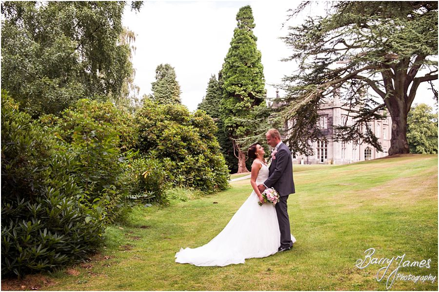Natural photographs of the relaxed bride and groom looking beautiful around the grounds of Hawkesyard Estate in Rugeley by Rugeley Wedding Photographer Barry James
