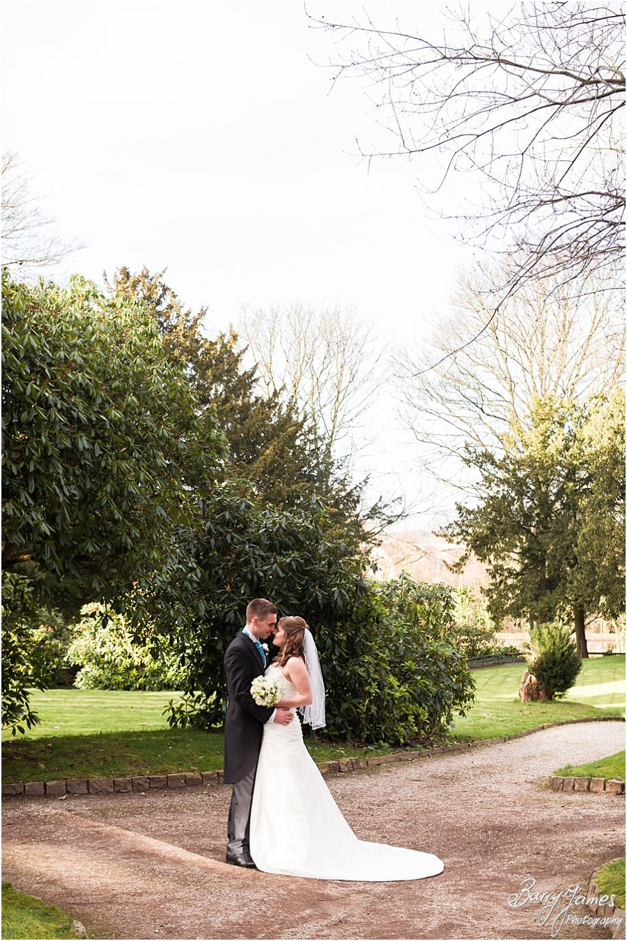 Elegant relaxed portraits of Bride and Groom around stunning grounds at Hawkesyard Hall in Rugeley by Professional Master Wedding Photographer Barry James