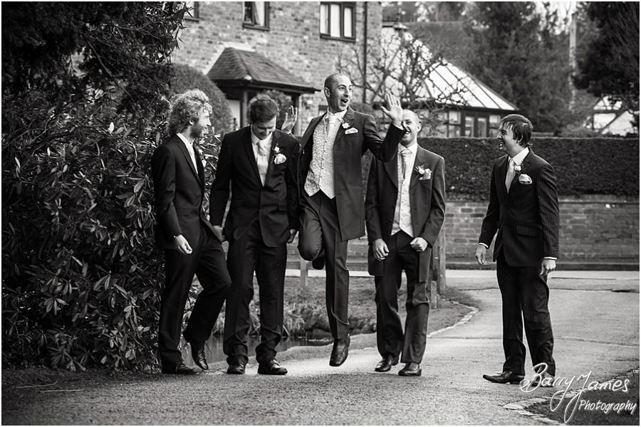 Contemporary and fun portraits of groom and groomsmen at The Moat House in Acton Trussell by Cannock Wedding Photographer Barry James