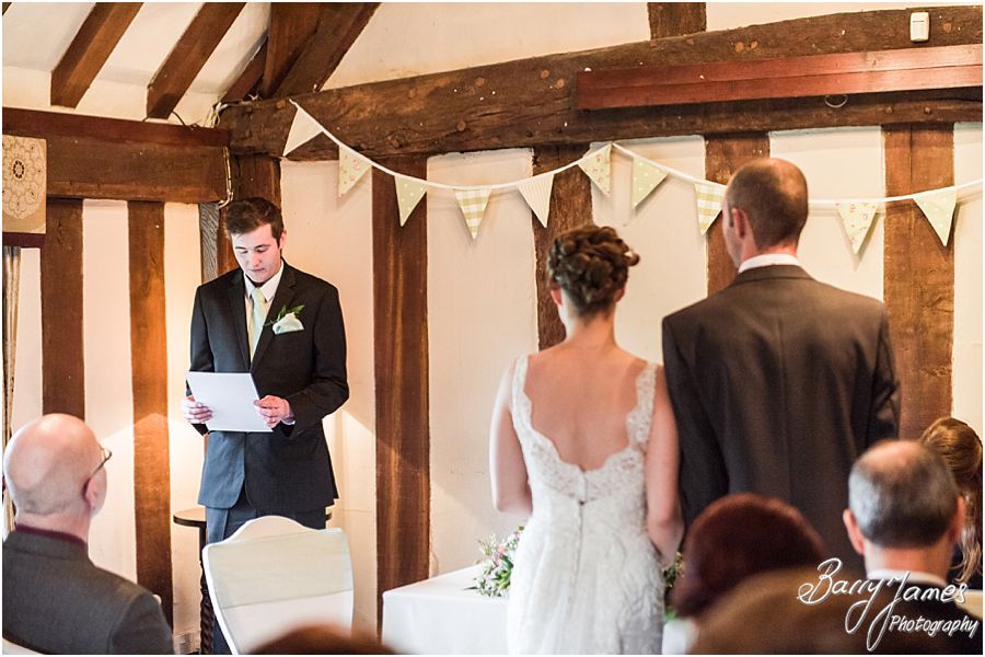 Capturing the beautiful wedding ceremony with contemporary and candid photographs at The Moat House in Acton Trussell by Full Time Professional Wedding Photographer Barry James