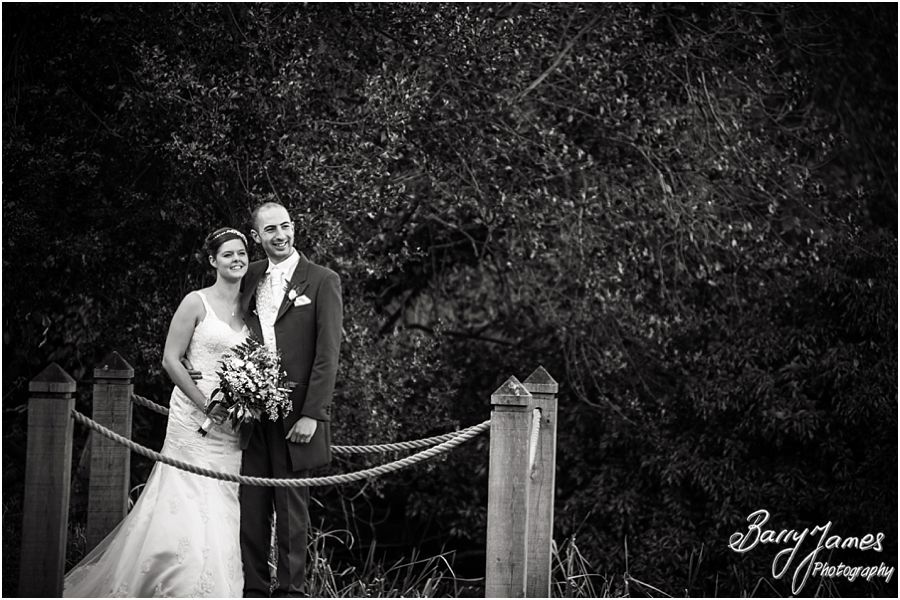 Contemporary stunning portrait photographs of bride and groom by the lake at The Moat House in Acton Trussell by Stafford Wedding Photographer Barry James