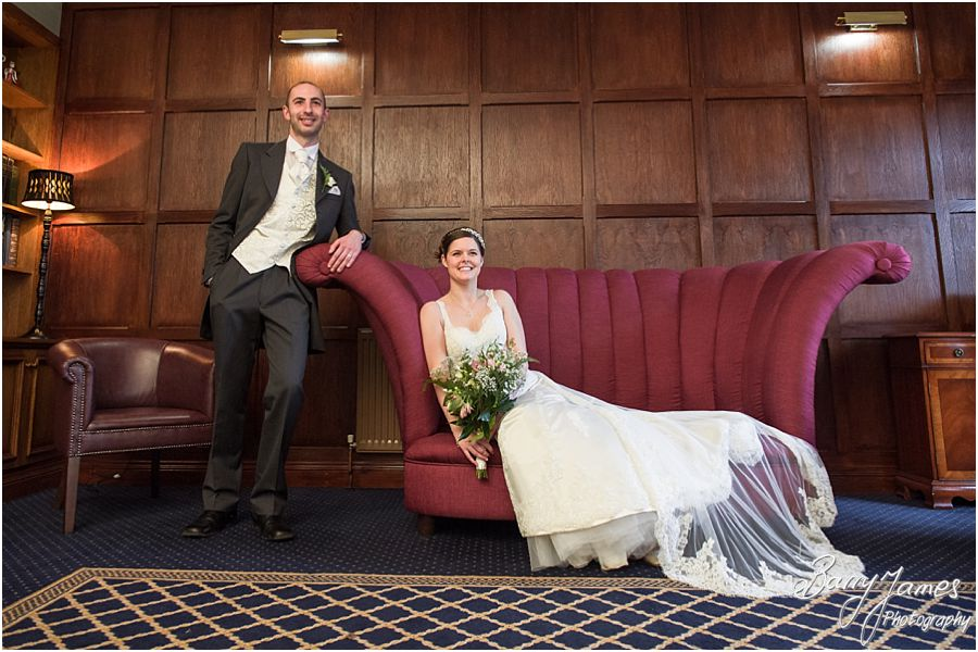 Beautiful photographs of the Bride and Groom inside the newly refurbished Library at The Moat House in Acton Trussell by Stafford Wedding Photographer Barry James