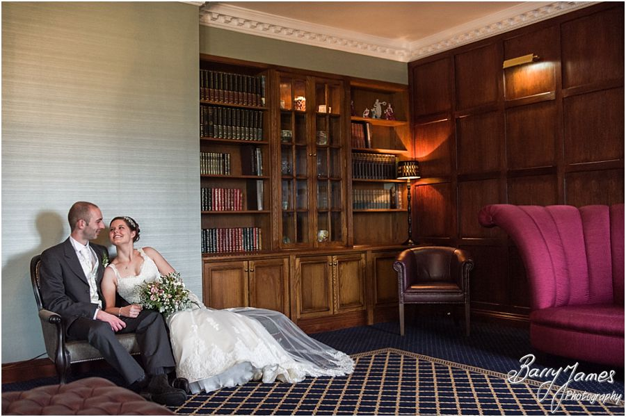 Utilising the stunning Library at The Moat House in Acton Trussell for couples photographs by Staffordshire Wedding Photographer Barry James