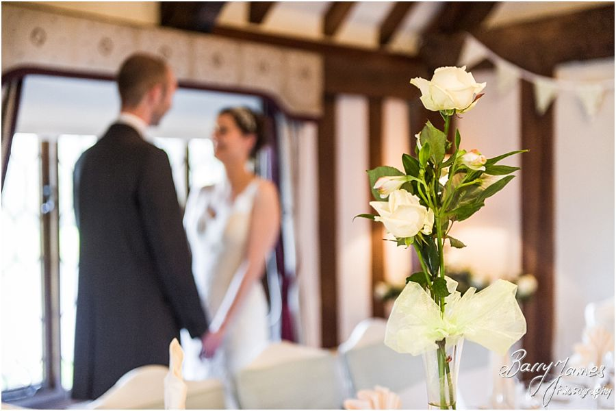 Intimate wedding breakfast setting in the Colin Lewis Suite at The Moat House in Acton Trussell by Rugeley Wedding Photographer Barry James