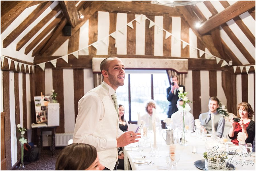 Candid photos of the speeches and guest reactions at The Moat House in Acton Trussell by Creative Contemporary Wedding Photographer Barry James