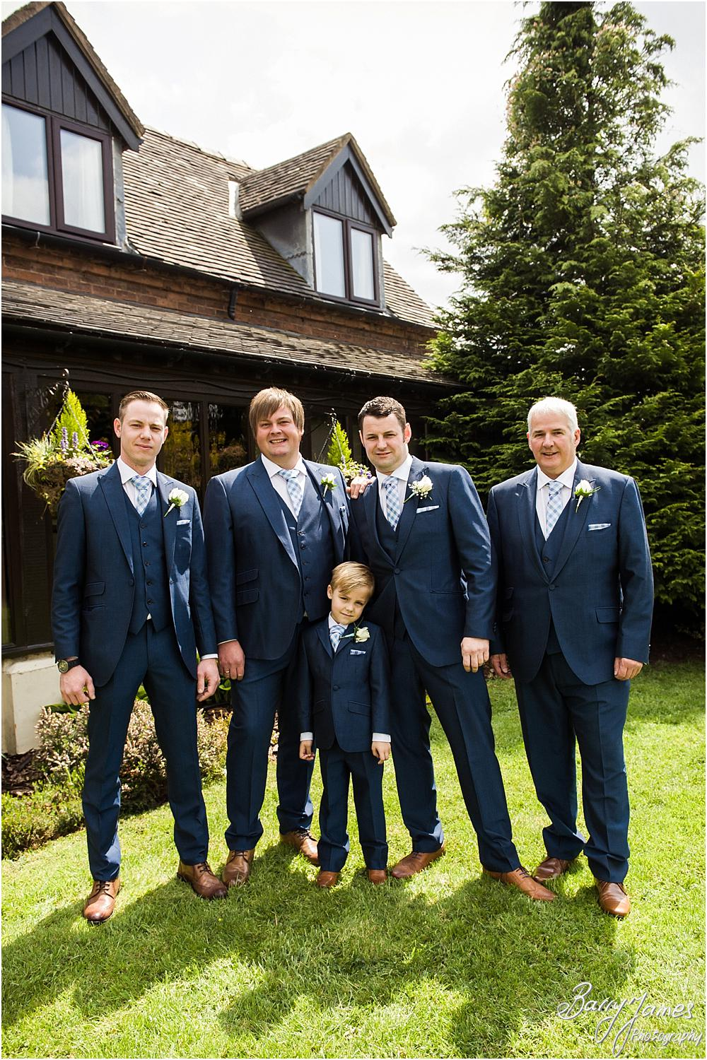 Contemporary photos of our relaxed groomsmen looking fabulous in their suits from A-Z Wedding Services Stourport at Oak Farm Hotel in Cannock by Cannock Wedding Photographers Barry James