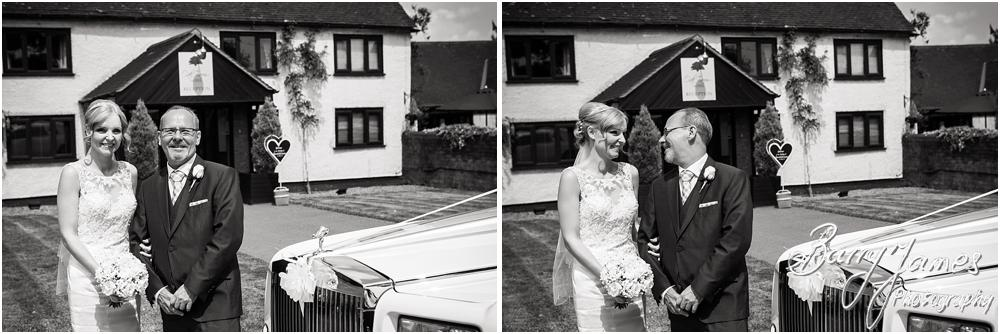 Lovely moments between the bride and her father just before the ceremony at Oak Farm Hotel in Cannock by Cannock Wedding Photographers Barry James