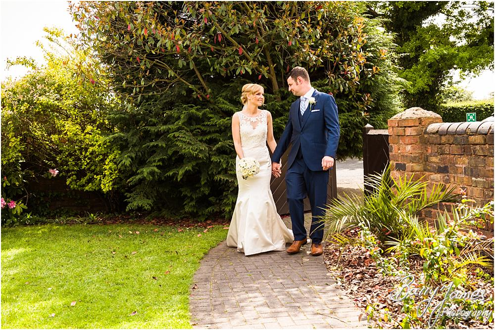 Creative contemporary portraits of the bride and groom at Oak Farm Hotel in Cannock by Cannock Wedding Photographers Barry James