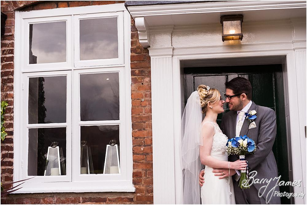 Contemporary photographs of the bride and groom on the old door at The Moat House in Acton Trussell by Acton Trussell Wedding Photographer Barry James