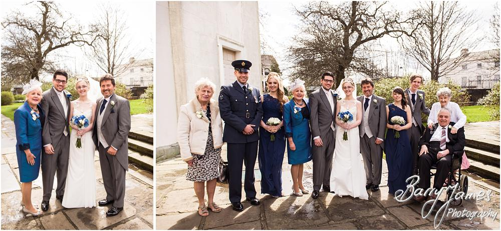Traditional family photos in the churchyard at St Leonards in Bilston by West Midlands Wedding Photographer Barry James