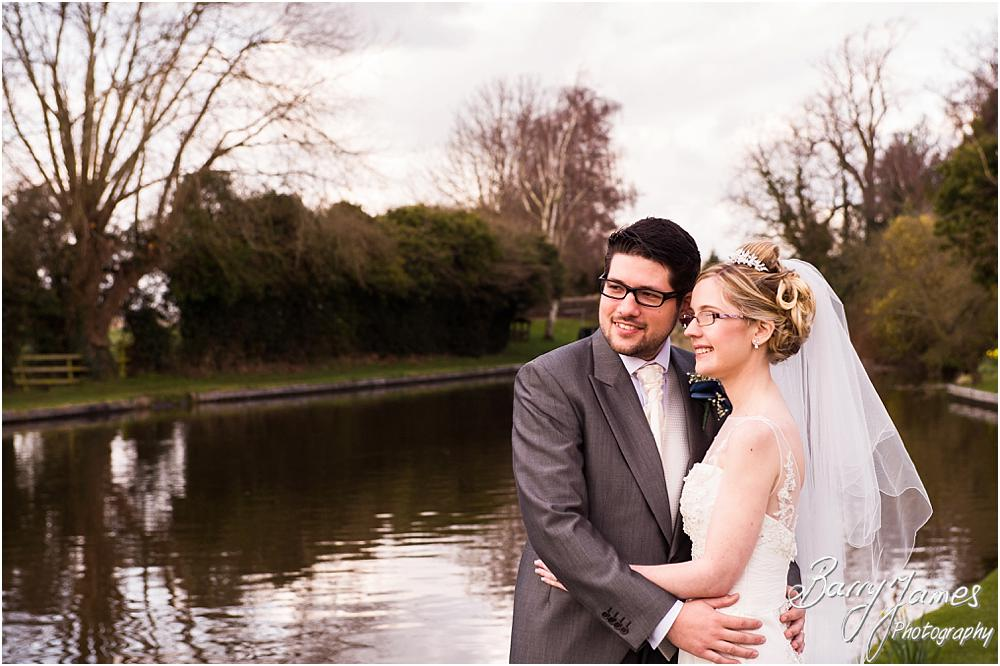 Beautiful portraits of the bride and groom on the canal side at The Moat House in Acton Trussell by Acton Trussell Wedding Photographer Barry James