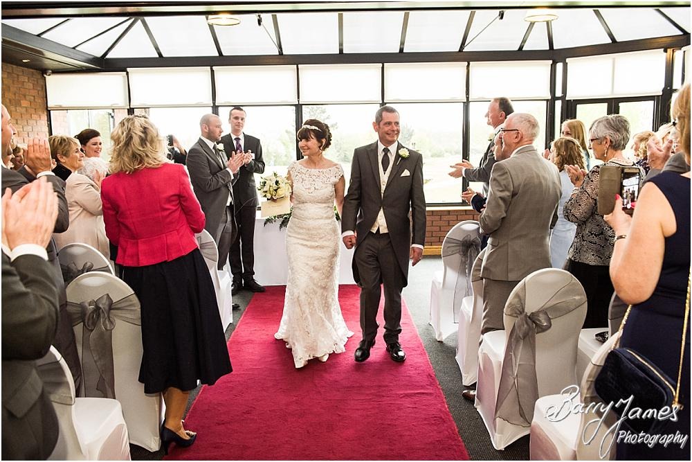 Unobtrusive photographs of the wedding ceremony at Calderfields in Walsall by Walsall Wedding Photographer Barry James