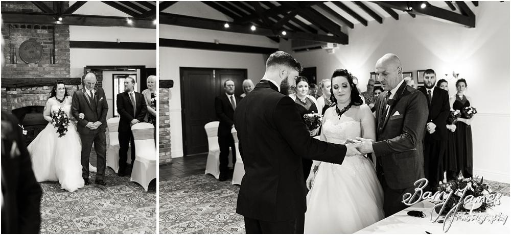 Candid photographs that capture the beautiful entrance to the ceremony at Oak Farm Hotel in Cannock Wedding Photographers Barry James