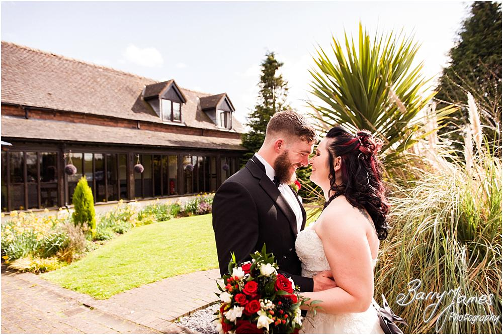 Relaxed contemporary portraits of the Bride and Groom in the front gardens at the beautiful Oak Farm Hotel in Cannock Wedding Photographers Barry James