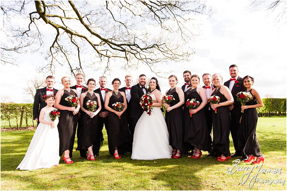 Relaxed and comfortable group photographs of the wedding party in the gardens at Oak Farm Hotel in Cannock Wedding Photographers Barry James
