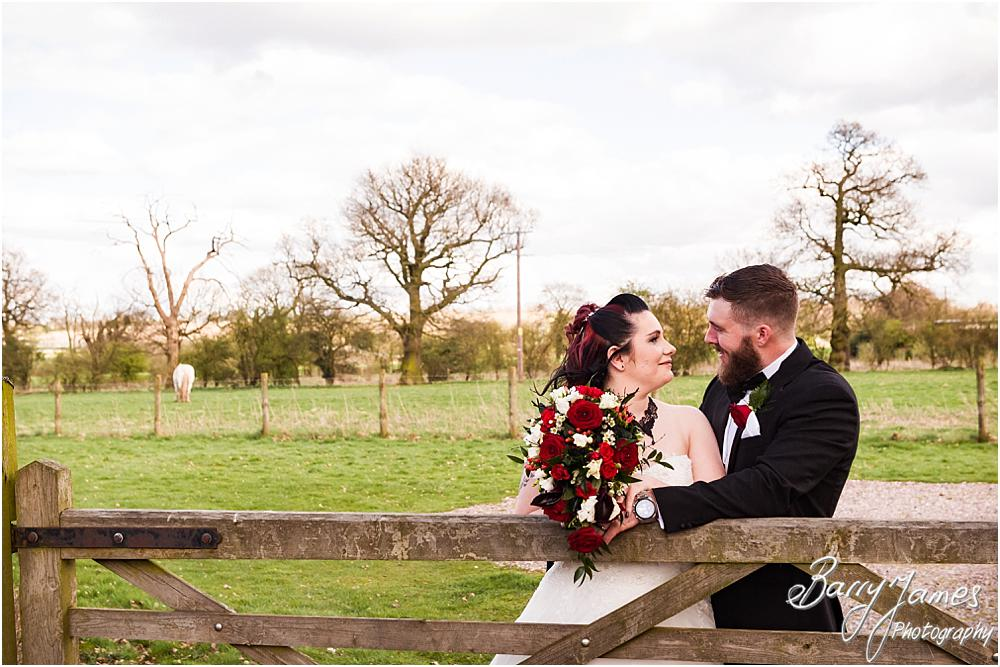 Beautiful contemporary portraits of the Bride and Groom in the grounds at Oak Farm Hotel in Cannock Wedding Photographers Barry James