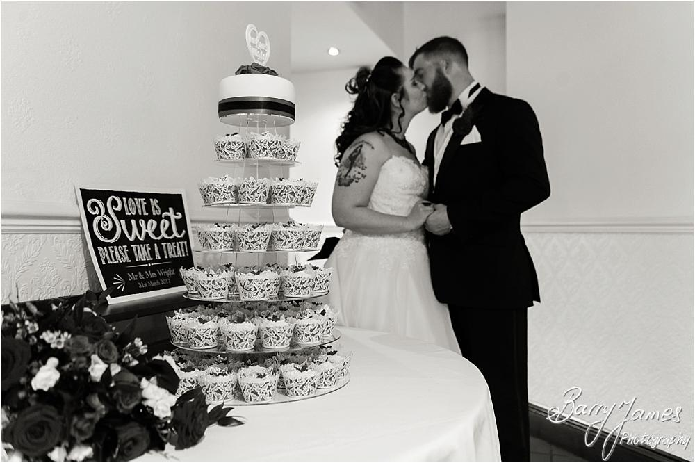 A wedding cake with a difference at Oak Farm Hotel in Cannock Wedding Photographers Barry James