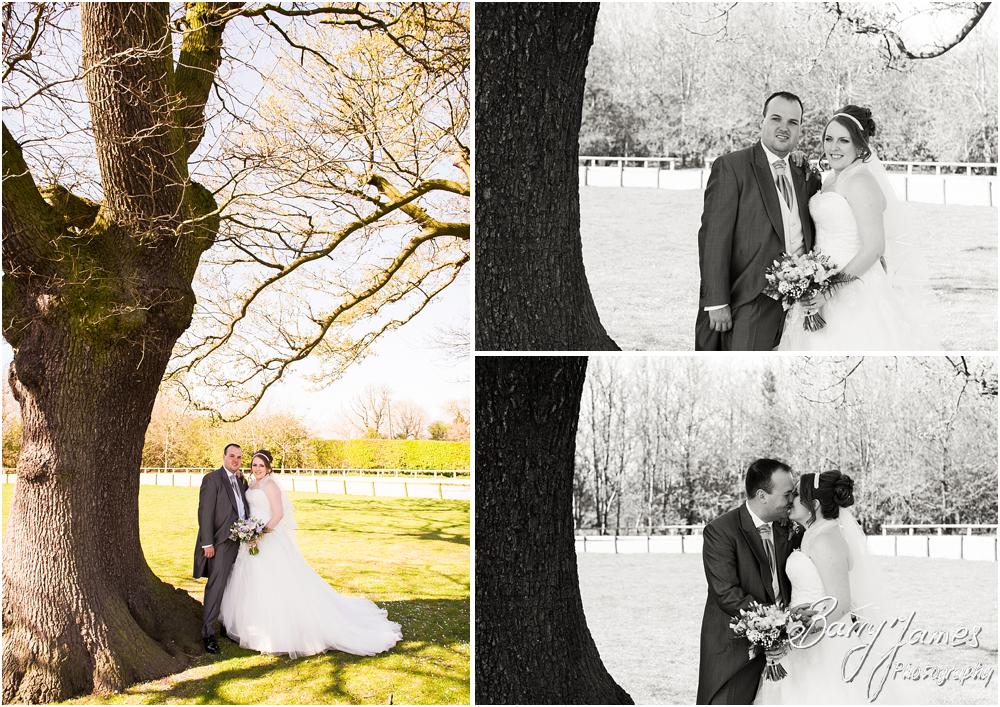 Creative portraits of the Bride and Groom in the beautiful gardens at Oak Farm Hotel in Cannock by Contemporary Cannock Wedding Photographer Barry James