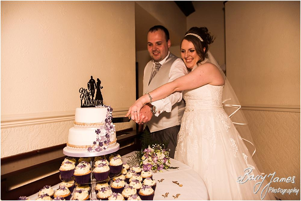 Cake cutting fun at Oak Farm Hotel in Cannock by Contemporary Cannock Wedding Photographer Barry James