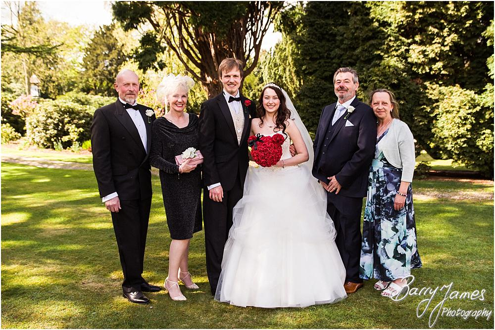 Natural photographs of the wedding party in the gardens at Hawkesyard Hall in Rugeley by Rugeley Wedding Photographer Barry James