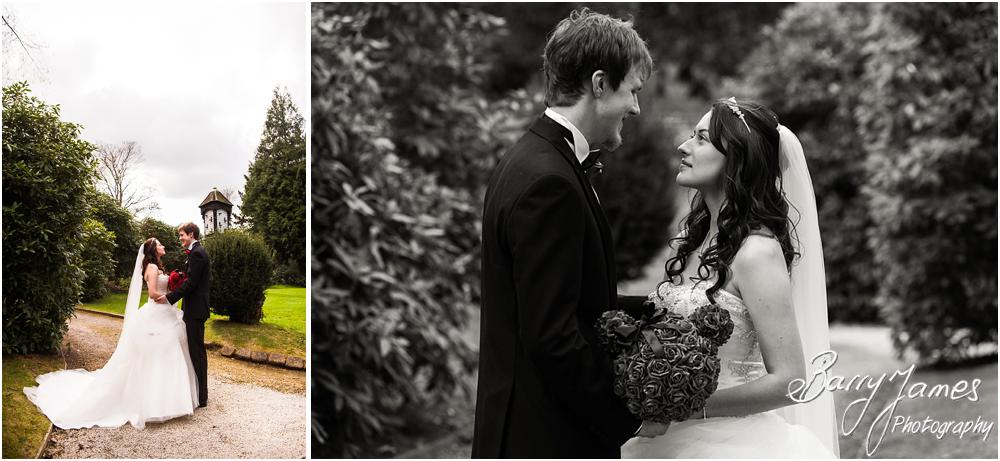 Creating beautiful images of the bride and groom around the stunning spring gardens at Hawkesyard Hall in Rugeley by Rugeley Wedding Photographer Barry James