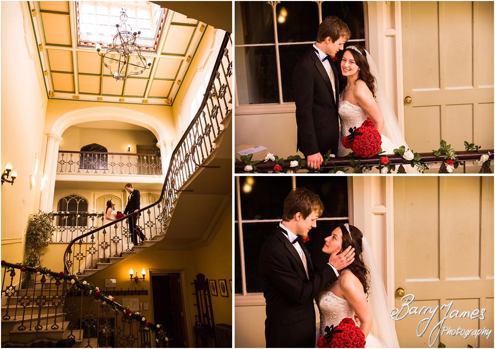 Utilising the beauty of the staircase and hallway at Hawkesyard Hall in Rugeley for creative portraits of the Bride and Groom by Rugeley Wedding Photographer Barry James