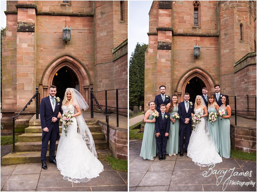 Contemporary family portraits on the steps at St Peters Little Aston in Sutton Coldfield by Sutton Coldfield Wedding Photographer Barry James