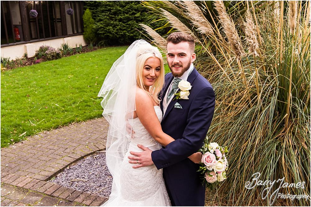 Creative and relaxed portraits of the bride and groom around the beautiful gardens at Oak Farm Hotel in Cannock by CannockWedding Photographer Barry James