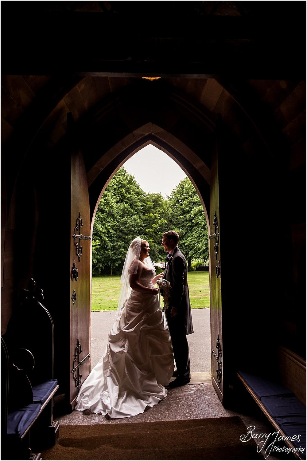 Creative photographs of the bride and groom in the beautiful doorway at St Marks in Great Wyrley by Penkridge Wedding Photographer Barry James
