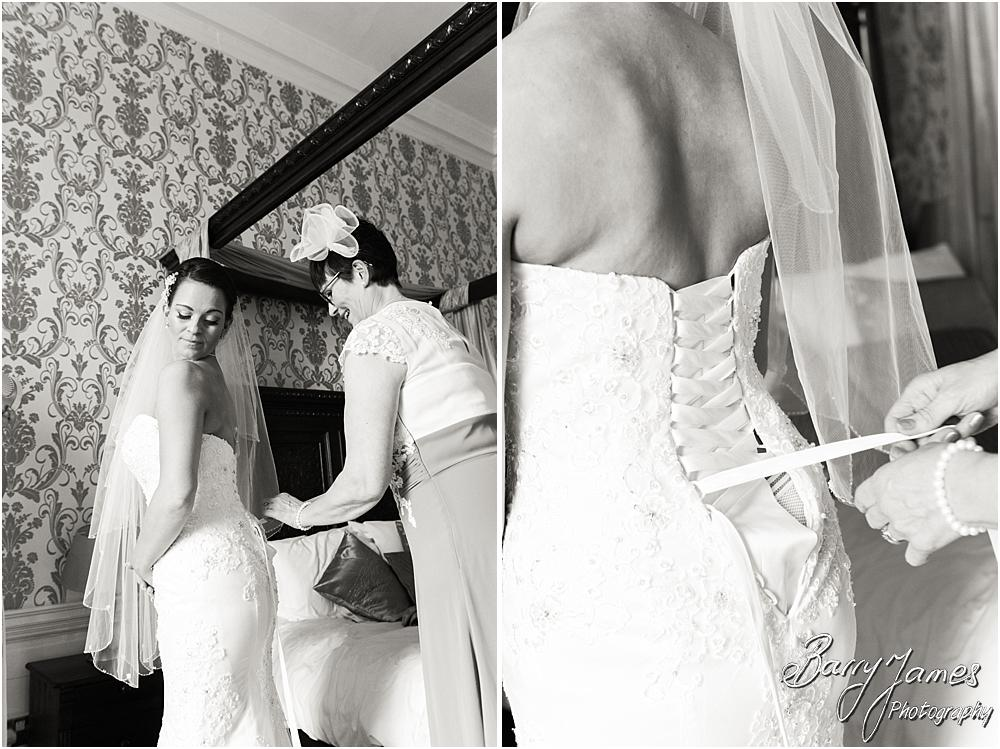 Candid photographs of the bridal dressing at Somerford Hall in Brewood by Wolverhampton Wedding Photographer Barry James
