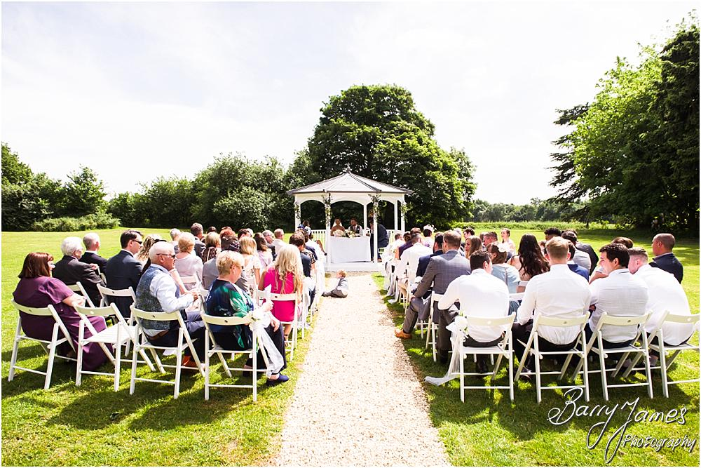 Unobtrusive candid photographs capturing the wedding ceremony at Somerford Hall in Brewood by Wolverhampton Wedding Photographer Barry James