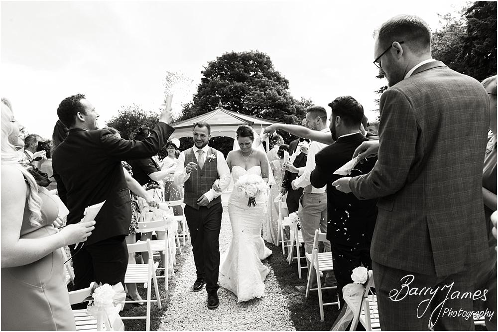 Confetti exit for the outdoor ceremony at Somerford Hall in Brewood by Wolverhampton Wedding Photographer Barry James