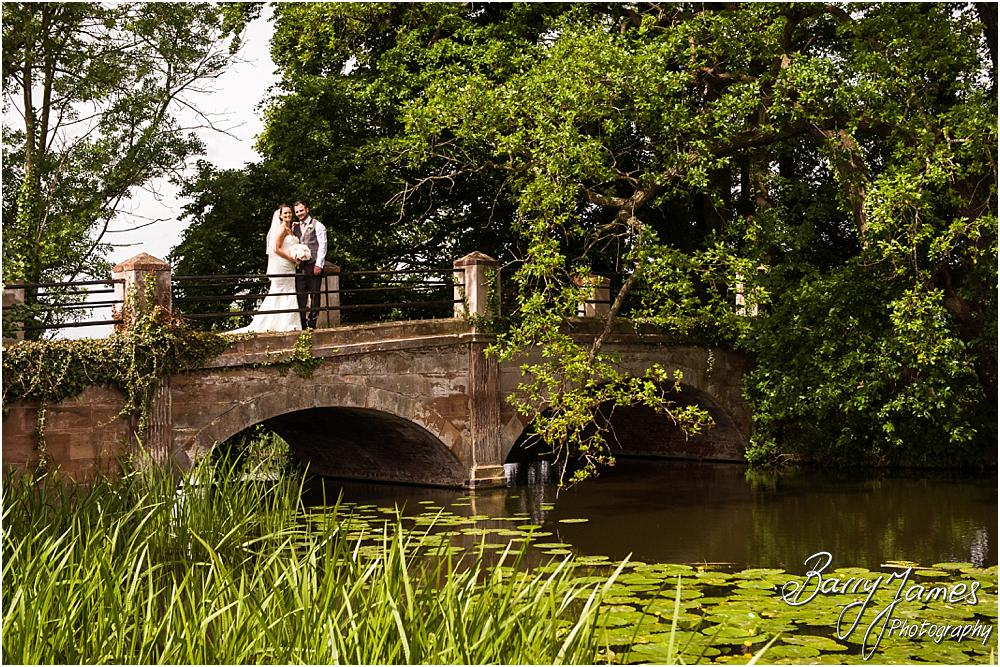 Beautiful creative portraits of the bride and groom at the bridge at Somerford Hall in Brewood by Wolverhampton Wedding Photographer Barry James
