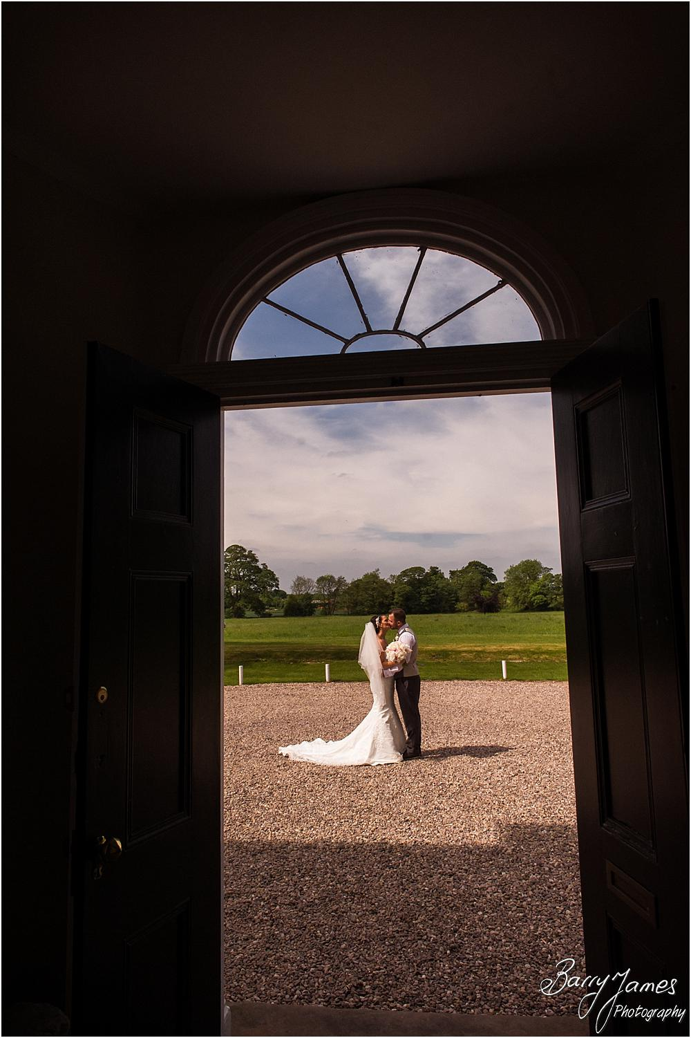 Creative photograph utilising the wonderful door at Somerford Hall in Brewood by Wolverhampton Wedding Photographer Barry James