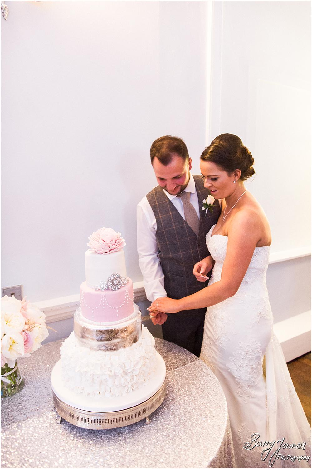 Capturing beautiful photographs during the cake cutting at Somerford Hall in Brewood by Wolverhampton Wedding Photographer Barry James
