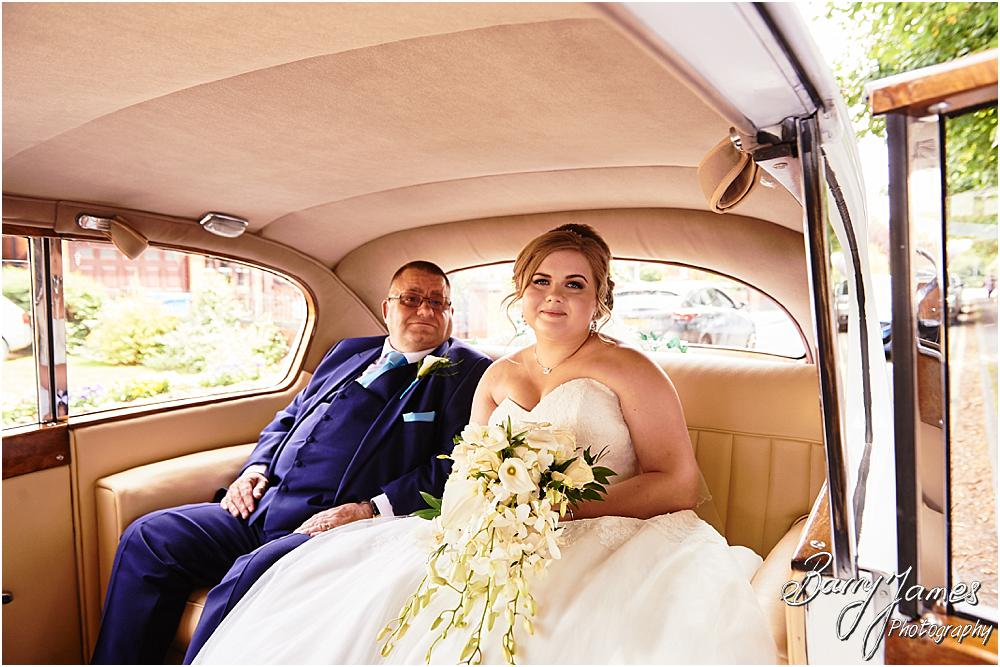 Creative and candid photographs of the bridal party arriving in style for the wedding ceremony at St Marks Church in Great Wyrley by Cannock Wedding Photographer Barry James