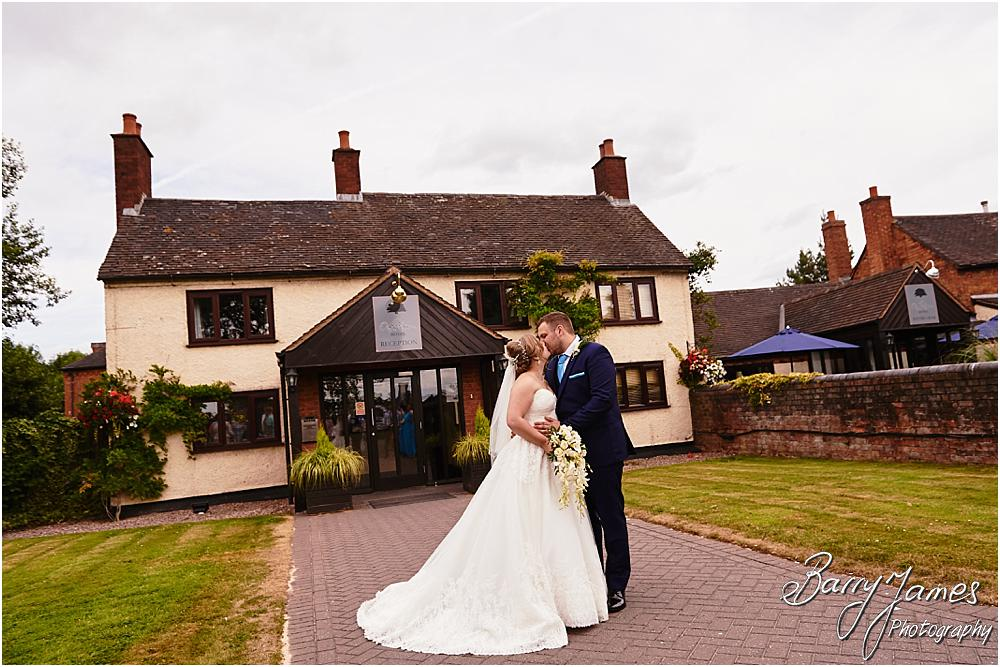 Beautiful photographs of the bride and groom utilising the fabulous setting at Oak Farm in Cannock by Cannock Wedding Photographer Barry James