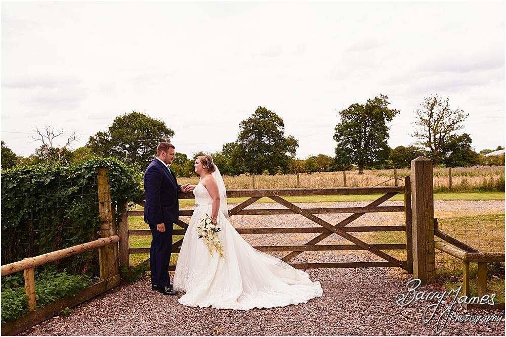 Gorgeous photographs of the Bride and Groom in the rear gardens at Oak Farm in Cannock by Cannock Wedding Photographer Barry James