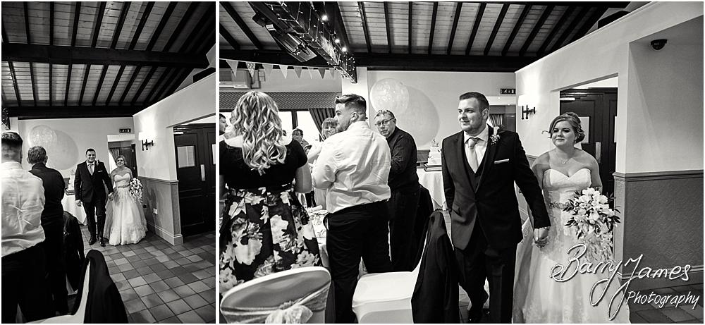Candid photographs of the wonderful entrance of the bride and groom to the reception at Oak Farm in Cannock by Cannock Wedding Photographer Barry James