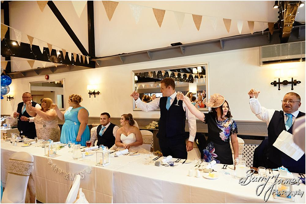 Creative candid photographs of the Father of the Bride speech at Oak Farm in Cannock by Cannock Wedding Photographer Barry James